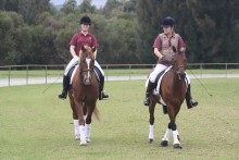 "Sam Burns riding ""Hero"". Leah Annesley riding ""Herbi"""